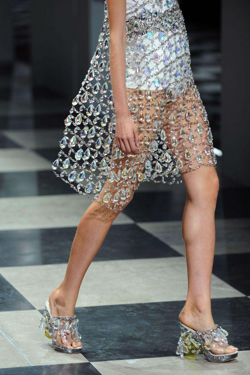 <p>A light-catching dress and matching shoes, on the designer's Spring 2010 runway.</p>