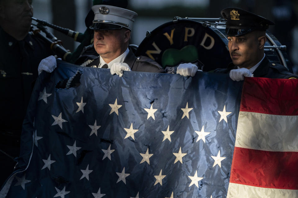 Flag bearers rehearse before ceremonies to commemorate the 20th anniversary of the Sept. 11 terrorist attacks, Saturday, Sept. 11, 2021, at the National September 11 Memorial & Museum in New York. (AP Photo/John Minchillo)