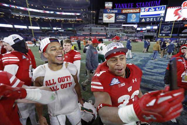 Wisconsin running back Jonathan Taylor (23) celebrates with teammates after Wisconsin defeated Miami 35-3 in the Pinstripe Bowl NCAA college football game Thursday, Dec. 27, 2018, in New York. (AP Photo/Adam Hunger)