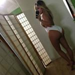 Kim Kardashian And Kanye West 'Couldn't Care Less' About Butt Selfie Backlash
