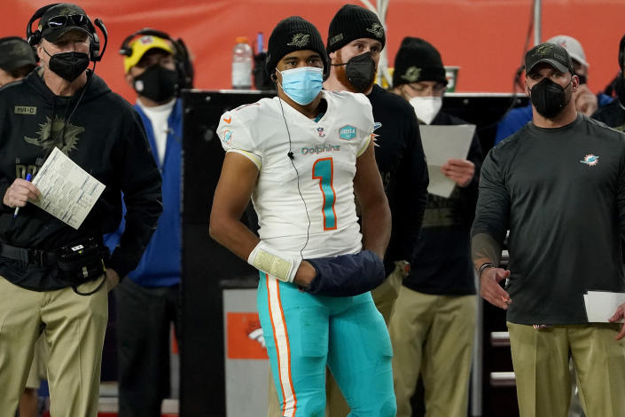 Miami Dolphins quarterback Tua Tagovailoa (1) watches the final minutes from the sidelines during the second half of an NFL football game against the Denver Broncos, Sunday, Nov. 22, 2020, in Denver. (AP Photo/Jack Dempsey)