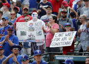 Fans hold up signs making reference to Globe Life Park and the Texas Rangers new facility, Globe Life Field before a baseball gam against the New York Yankees in Arlington, Texas, Sunday, Sept. 29, 2019. The Rangers are scheduled to play the 2020 season in the new stadium. (AP Photo/Tony Gutierrez)