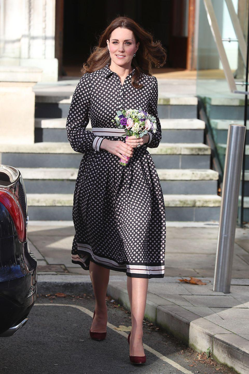 <p>The Duchess wears a Kate Spade dress and maroon suede pumps during her visit to The Foundling Museum in London. </p>