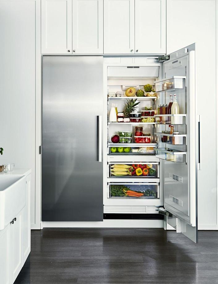 """<p>In addition to wiping down your fridge's interior shelving on a regular basis, give the removable bins and shelves a deep clean every now and again. Pop out the door shelves and bins, and wash in warm, soapy water to get rid of food bacteria and spillage.</p><p><strong>RELATED: </strong><a href=""""https://www.goodhousekeeping.com/home/organizing/g26087384/fridge-organization-ideas/"""" rel=""""nofollow noopener"""" target=""""_blank"""" data-ylk=""""slk:The Best Way to Organize a Fridge"""" class=""""link rapid-noclick-resp"""">The Best Way to Organize a Fridge</a></p>"""