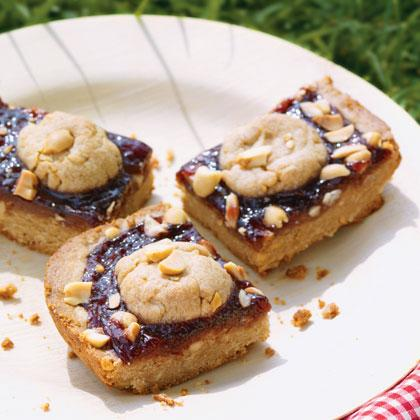 "<div class=""caption-credit""> Photo by: FamilyFun.go.com</div><div class=""caption-title""></div><p>   <b>PB & J Bars</b> </p> <p>   Here's a sweet twist on an enduring kid combo. A layer of jam is sandwiched between a moist peanut butter crust and a crumbly peanut topping. Yum! </p> <p>   <a rel=""nofollow"" href=""http://familyfun.go.com/recipes/pb-and-j-bars-877049/?cmp=OTC_Shine_RoadTripSnacks_FFUN"">Get the Recipe</a> </p>"