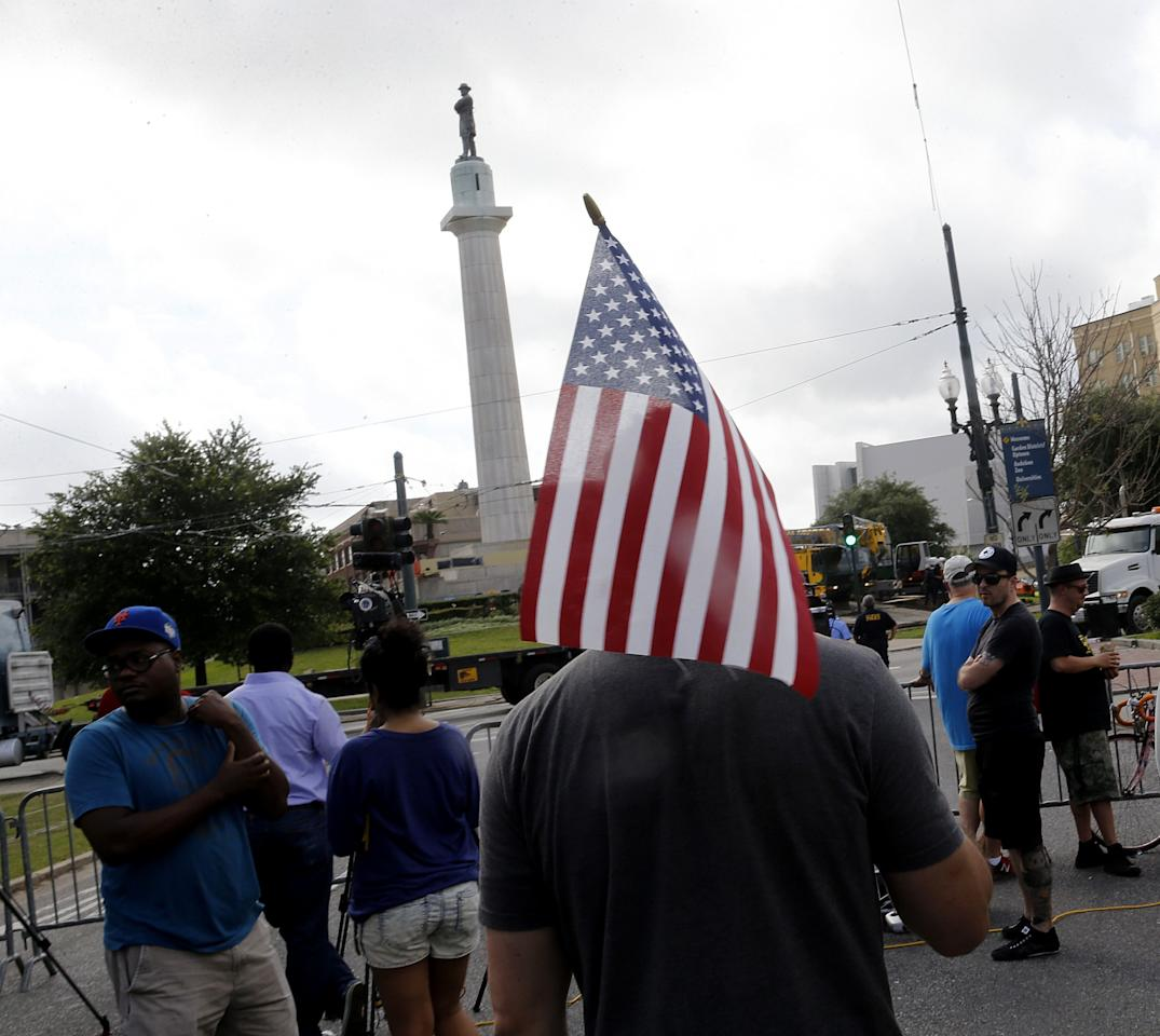 <p>Onlookers stand by as workers prepare to take down a statue of Gen. Robert E. Lee, who commanded Confederate armies fighting the United States in the Civil War, at Lee Circle in New Orleans, Friday, May 19, 2017. (Photo: Gerald Herbert/AP) </p>
