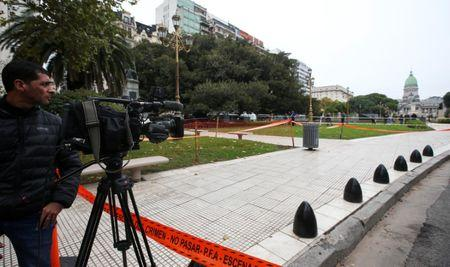 A cameraman works at the crime scene where Argentine Congressman Hector Olivares was injured and his adviser, Miguel Yadon, was killed in an attack near the National Congress in Buenos Aires, Argentina May 9, 2019. REUTERS/Agustin Marcarian