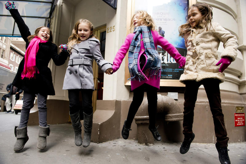 """Actresses from left, Bailey Ryon, Sophia Gennusa, Milly Shapiro and Oona Laurence, who will share the title role in """"Matilda the Musical"""" on Broadway, pose for a portrait outside the Shubert Theatre, on Thursday, Nov. 15, 2012 in New York. (Photo by Charles Sykes/Invision/AP)"""