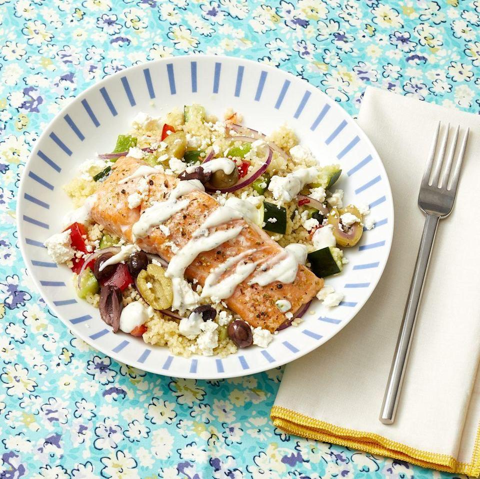 """<p>Looking to use salmon in a healthy family meal? Top couscous with baked salmon, bell peppers, cucumber, olives, and tzatziki.</p><p><a href=""""https://www.thepioneerwoman.com/food-cooking/recipes/a35938406/greek-salmon-couscous-bowls-recipe/"""" rel=""""nofollow noopener"""" target=""""_blank"""" data-ylk=""""slk:Get Ree's recipe."""" class=""""link rapid-noclick-resp""""><strong>Get Ree's recipe.</strong></a> </p>"""