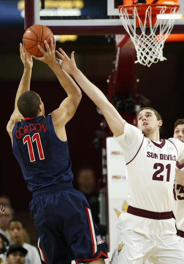 Arizona's Aaron Gordon (11) shoots over Arizona State's Eric Jacobsen (21) during the first half of an NCAA college basketball game on Friday, Feb. 14, 2014, in Tempe, Ariz. (AP Photo/Ross D. Franklin)