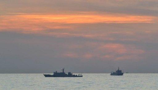 """Chinese surveillance ships are seen off the disputed Scarborough Shoal, close to the Philippines, in April. China on Saturday attacked US criticism of its decision to set up a new military garrison in the South China Sea, saying it sent the """"wrong signal"""" and threatened peace in the hotly disputed waters"""