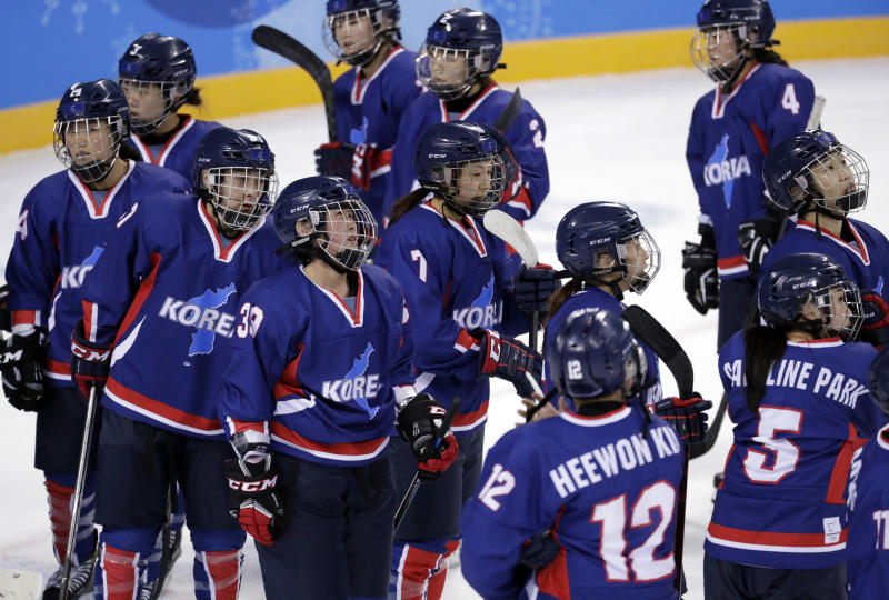 Players of the combined Koreas react after the preliminary round of the women's hockey game against Sweden at the 2018 Winter Olympics in Gangneung, South Korea, Monday, Feb. 12, 2018. Sweden won 8-0. (AP Photo/Julio Cortez)