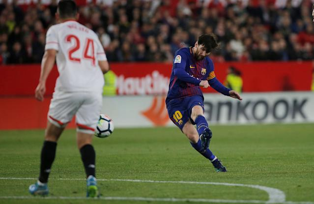 Soccer Football – La Liga Santander – Sevilla vs Barcelona – Ramon Sanchez Pizjuan, Seville, Spain – March 31, 2018 Barcelona's Lionel Messi scores their second goal REUTERS/Jon Nazca