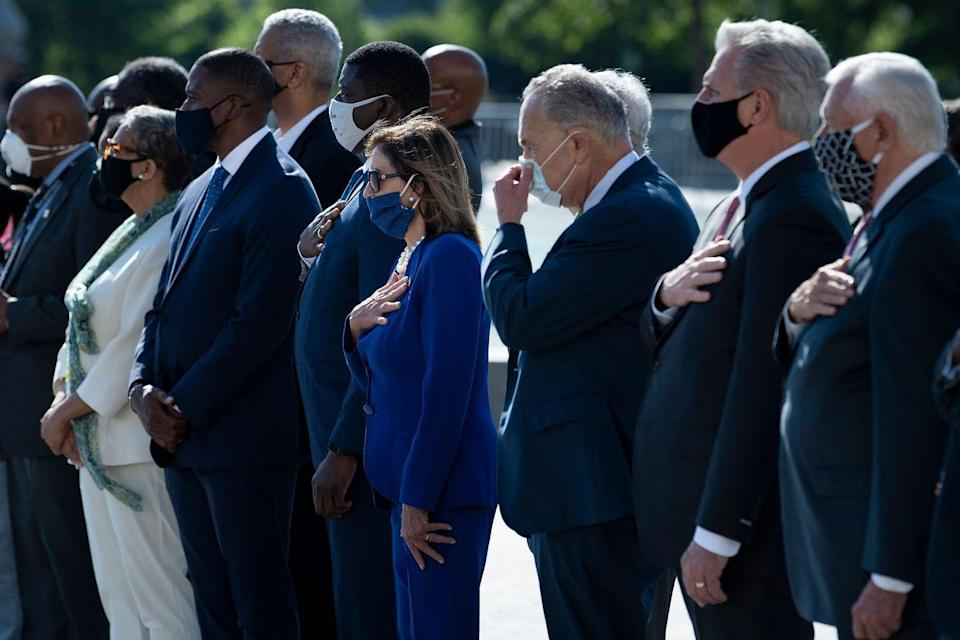 <p>House Speaker Nancy Pelosi and other lawmakers placed their hands over their hearts as they watched Lewis's casket leave the Capitol. </p>
