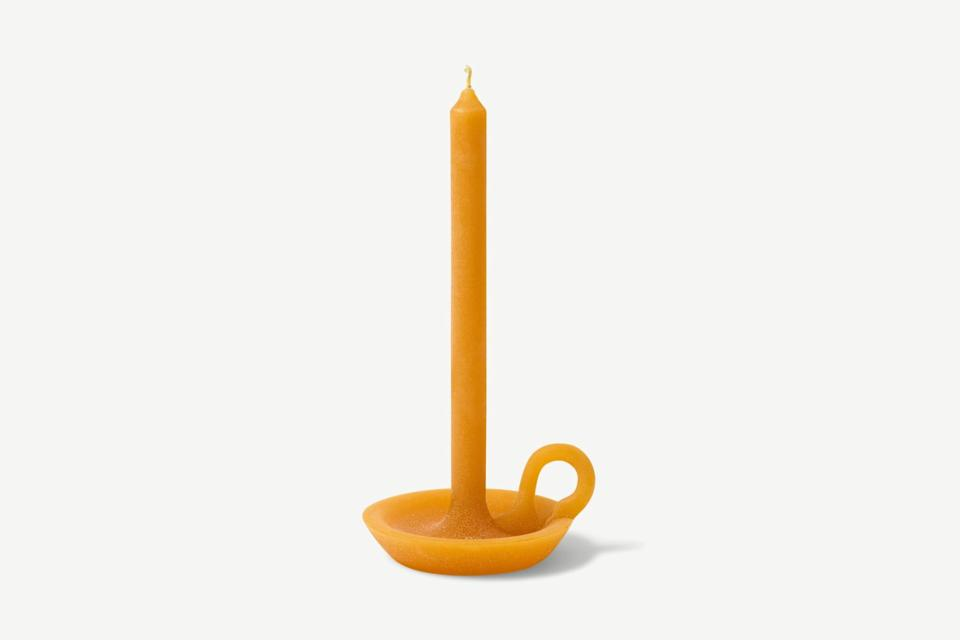 """<strong>Under £50</strong><br><br>Do I need this unbearably sleek, incredibly impractical, all-in-one candlestick holder hybrid? No. Do I yearn for it in all its waxy messiness and threats to ruin my table? You can bet on it. <br><br><strong>Made</strong> 54 Celsius Tallow Single Wick Candle, $, available at <a href=""""https://www.made.com/54-celsius-tallow-single-wick-candle-deep-ochre"""" rel=""""nofollow noopener"""" target=""""_blank"""" data-ylk=""""slk:Made"""" class=""""link rapid-noclick-resp"""">Made</a>"""