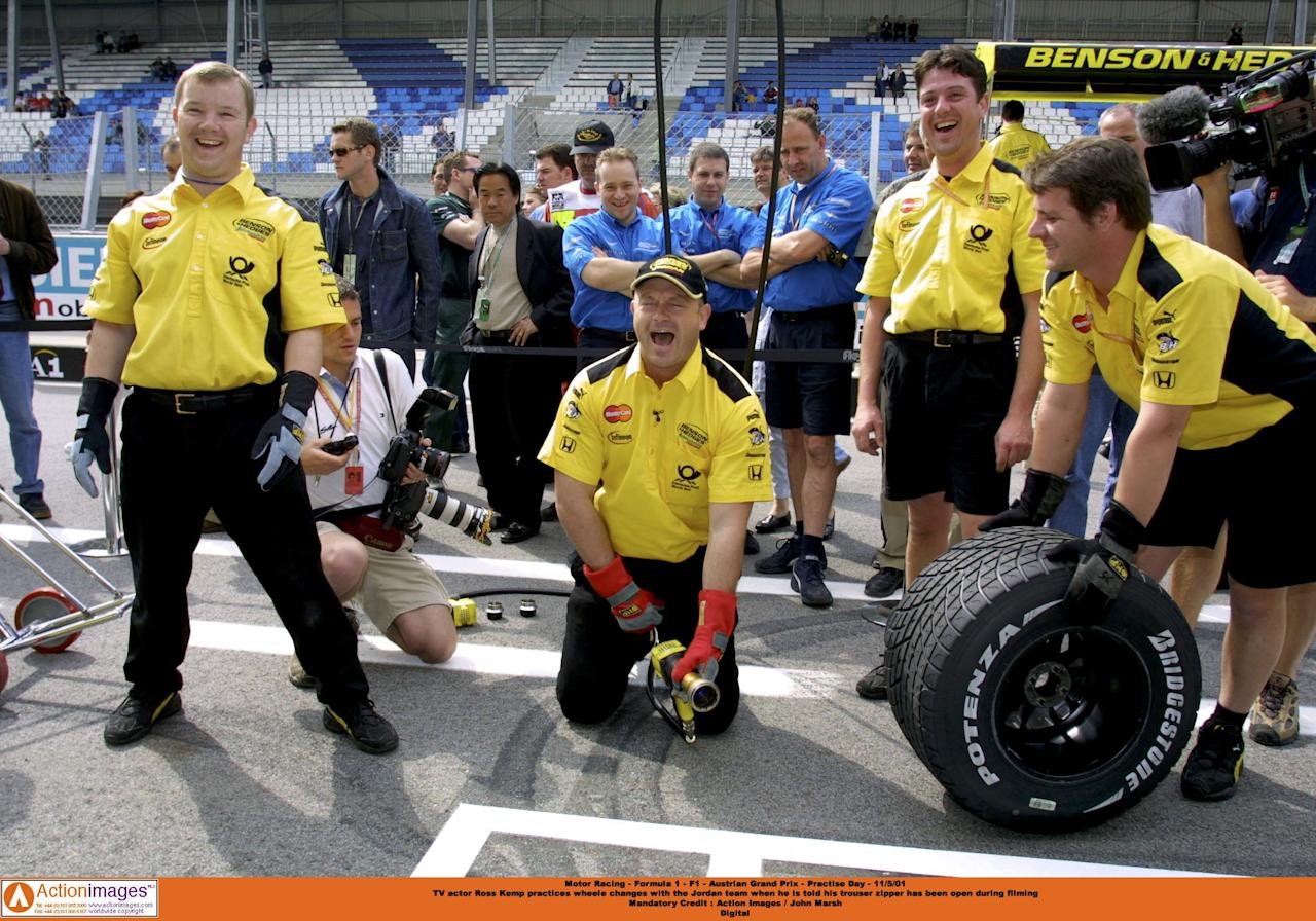 Motor Racing - Formula 1 - F1 - Austrian Grand Prix - Practise Day - 11/5/01  TV actor Ross Kemp practices wheele changes with the Jordan team when he is told his trouser zipper has been open during filming  Mandatory Credit : Action Images / John Marsh  Digital