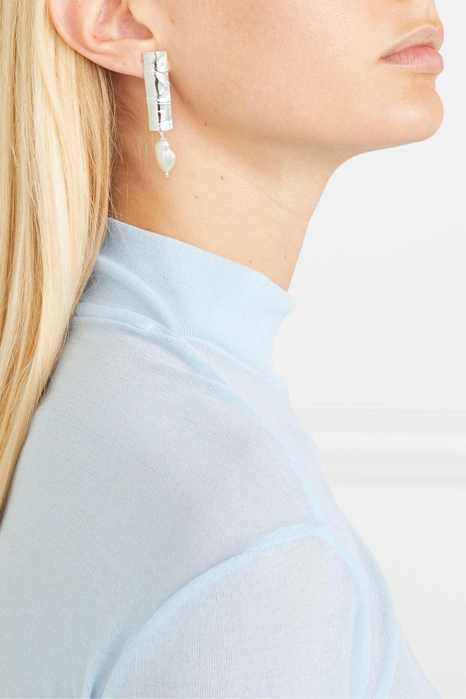 """<h3>Leigh Miller Sterling Silver and Pearl Earrings</h3> <br><br>It's rare that precious jewelry gets marked down, but it does happen once in a blue moon. That's why we always keep on eye on the sale section on sites like Net-a-Porter, to see if any of our wish-listed baubles have made the cut.<br><br><em>Shop jewelry on sale at <strong><a href=""""https://www.net-a-porter.com/en-us/shop/sale/jewelry-and-watches"""" rel=""""nofollow noopener"""" target=""""_blank"""" data-ylk=""""slk:Net-A-Porter"""" class=""""link rapid-noclick-resp"""">Net-A-Porter</a></strong></em><br><br><strong>Leigh Miller</strong> Sterling Silver and Pearl Earrings, $, available at <a href=""""https://go.skimresources.com/?id=30283X879131&url=https%3A%2F%2Fwww.net-a-porter.com%2Fen-us%2Fshop%2Fproduct%2Fleigh-miller%2Fnet-sustain-silver-and-pearl-earrings%2F1186155"""" rel=""""nofollow noopener"""" target=""""_blank"""" data-ylk=""""slk:Net-A-Porter"""" class=""""link rapid-noclick-resp"""">Net-A-Porter</a><br><br><br><br>"""
