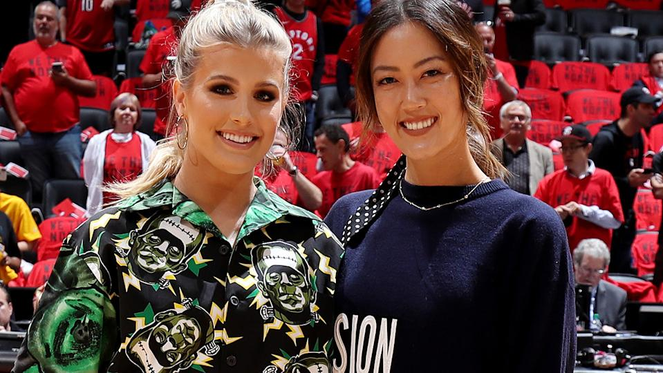 Eugenie Bouchard and golf star Michelle Wie, pictured here at the NBA Finals in 2019.