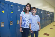 In this Thursday, June 6, 2013 photo, Julia Nagel, left, and her twin brother, Alexander, one of the twenty-four sets of twins from Highcrest Middle School in Wilmette, Ill., pose for a portrait at the school. The group is attempting to break a Guinness World record for the amount of twins in one grade which is currently 16 sets. (AP Photo/Scott Eisen)