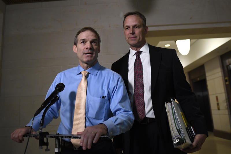 Rep. Jim Jordan, R-Ohio, left, and Rep. Scott Perry, R-Pa., right, speak to reporters on Capitol Hill in Washington, Thursday, Oct. 31, 2019, outside the are where witnesses are interviewed for the impeachment inquiry. (AP Photo/Susan Walsh)