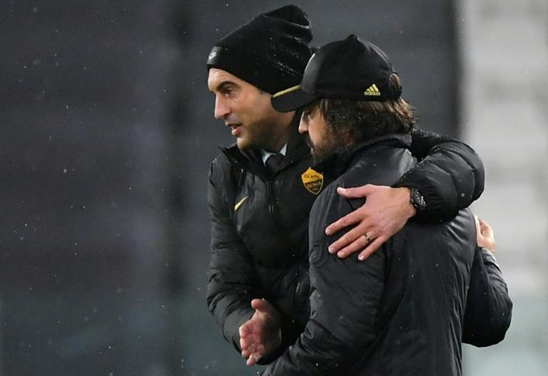 Pirlo (R) and his Roma counterpart Fonseca greet each other in Turin