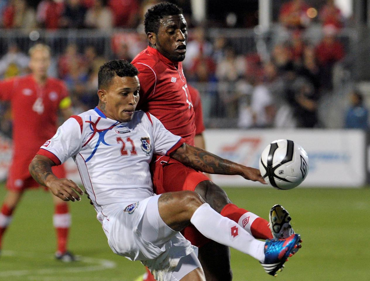 FILE PHOTO - Panama's Amilcar Henriquez (L) fights for the ball against Canada's Olivier Occean during their 2014 World Cup qualifying soccer match in Toronto September 7, 2012.    REUTERS/ Mike Cassese/File Photo