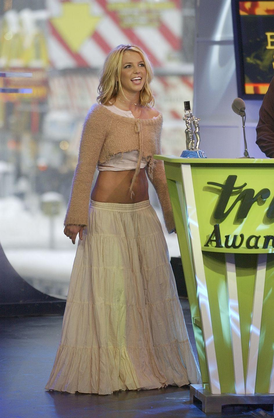 <p>While I'm vibing with Britney's attempt at tonal dressing way before it was trendy, someone needs to find out what happened to the singer's sweater. </p>