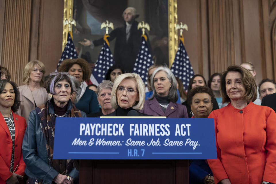 Lilly Ledbetter, center, an activist for workplace equality, is flanked by Speaker of the House Nancy Pelosi, D-Calif., right, and Rep. Rosa DeLauro, D-Conn., sponsor of the Paycheck Fairness Act, left, speaks at an event to advocate for the Paycheck Fairness Act on the 10th anniversary of President Barack Obama signing the Lilly Ledbetter Fair Pay Act, at the Capitol in Washington, Wednesday, Jan. 30, 2019. The legislation, a top tier issue for the new Democratic majority in the House, would strengthen the Equal Pay Act of 1963 and guarantee that women can challenge pay discrimination and hold employers accountable.(AP Photo/J. Scott Applewhite)