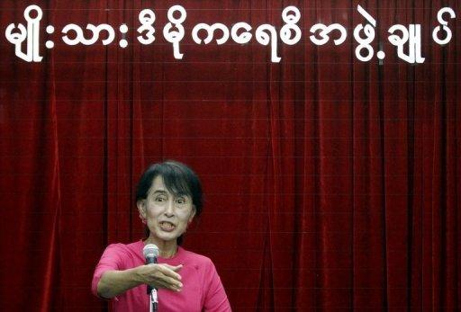 Aung San Suu Kyi speaks during a press conference