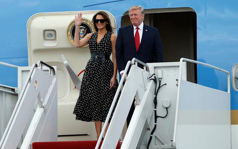 President Donald Trump and first lady Melania Trump arrive on Air Force One at Palm Beach International Airport in West Palm Beach, Fla., on Thursday, April 6, 2017 - FR170673 AP