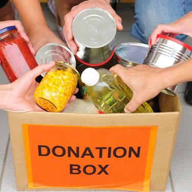 People-putting-food-in-a-donation-box_web