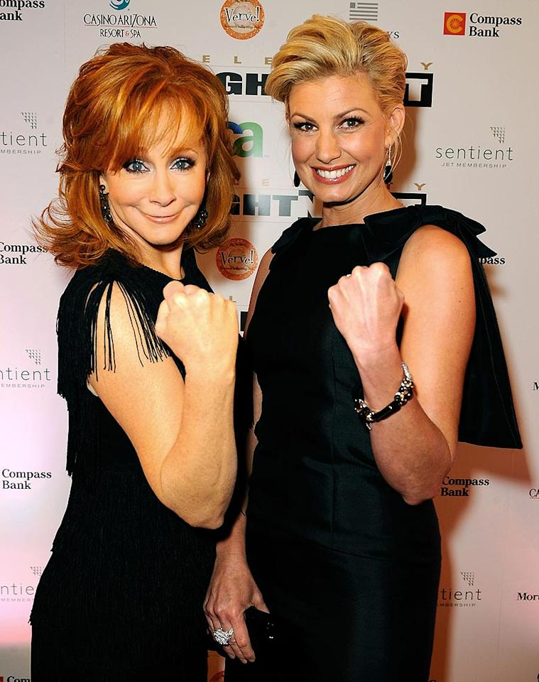 """Reba McEntire and Faith Hill flex their guns at Muhammad Ali's Celebrity Fight Night XIV in Scottsdale, Arizona. Proceeds from the annual event go to numerous charities, including the Muhammed Ali Parkinson's Center. The boxer was diagnosed with the disease in 1984. Michael Caulfield/<a href=""""http://www.wireimage.com"""" target=""""new"""">WireImage.com</a> - April 5, 2008"""