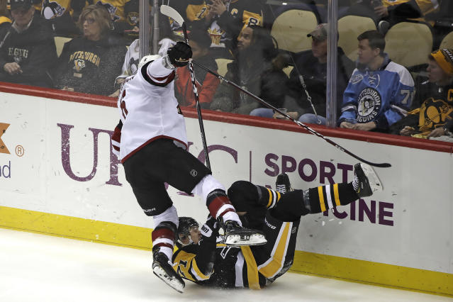 Arizona Coyotes' Jakob Chychrun, left, collides with Pittsburgh Penguins' Evgeni Malkin (71) during the first period of an NHL hockey game in Pittsburgh, Friday, Dec. 6, 2019. (AP Photo/Gene J. Puskar)