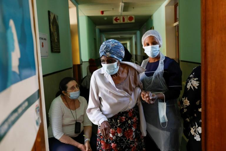 Nearly six billion vaccine doses have been administered globally, but only two percent of those have been in Africa (AFP/Phill Magakoe)