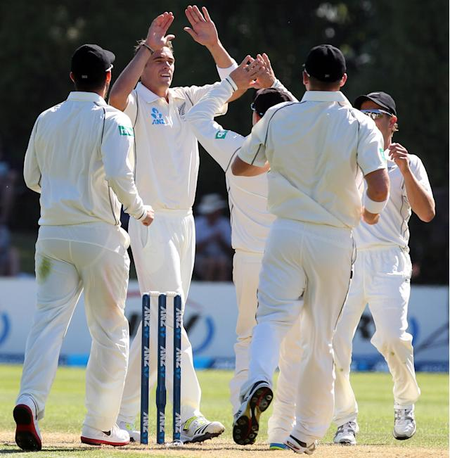 DUNEDIN, NEW ZEALAND - DECEMBER 04: New Zealand players rush to congratulate Tim Southee after claiming a West Indies wicket during day two of the first test match between New Zealand and the West Indies at University Oval on December 4, 2013 in Dunedin, New Zealand. (Photo by Rob Jefferies/Getty Images)