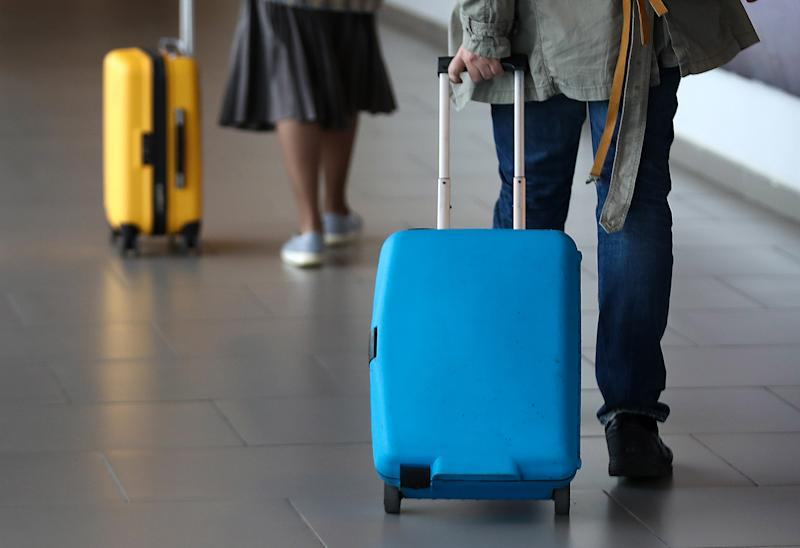 ST PETERSBURG, RUSSIA - APRIL 19, 2019: Passengers with suitcases at Pulkovo International Airport. Valery Sharifulin/TASS (Photo by Valery Sharifulin\TASS via Getty Images)