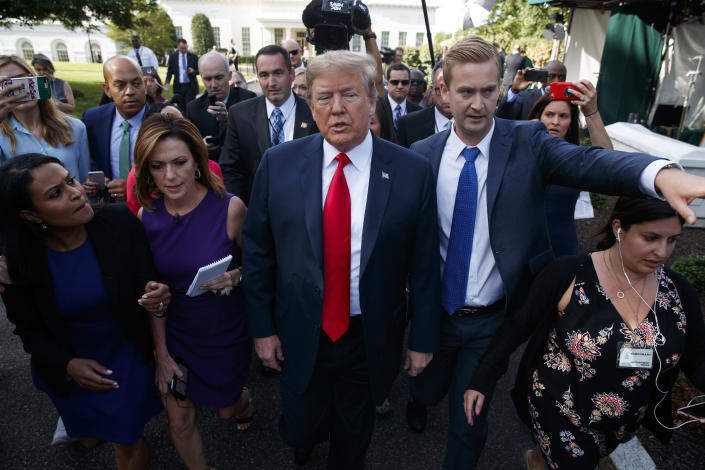 President Trump walks to an interview on the North Lawn of the White House on Friday. (Photo: Evan Vucci/AP)