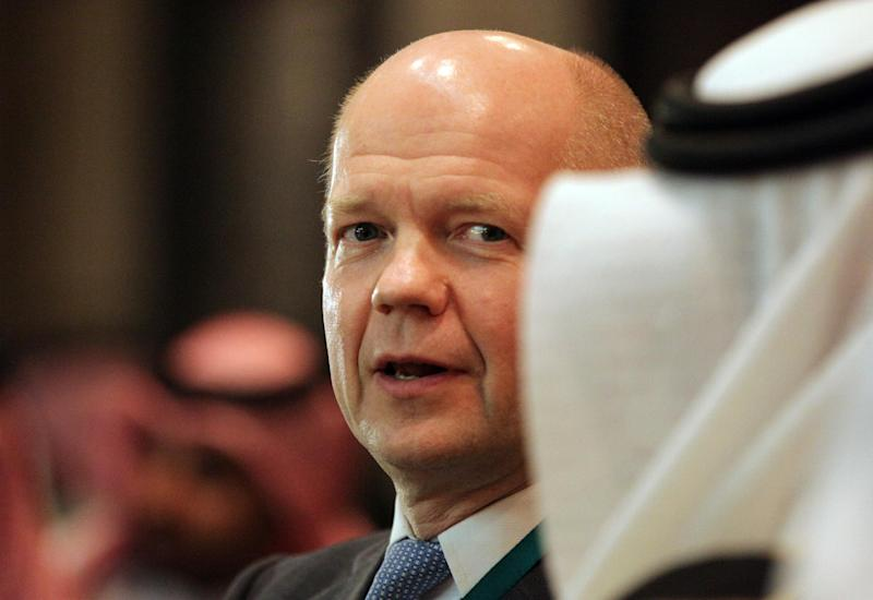 British Foreign Secretary William Hague arrives for the opening of the International Institute of Strategic Studies (IISS) conference in Manama, Bahrain, on Friday, Dec. 6, 2013. The IISS Manama conference is expected to discuss regional security issues including the recently reached deal on Iran's nuclear program. (AP Photo/Hasan Jamali)