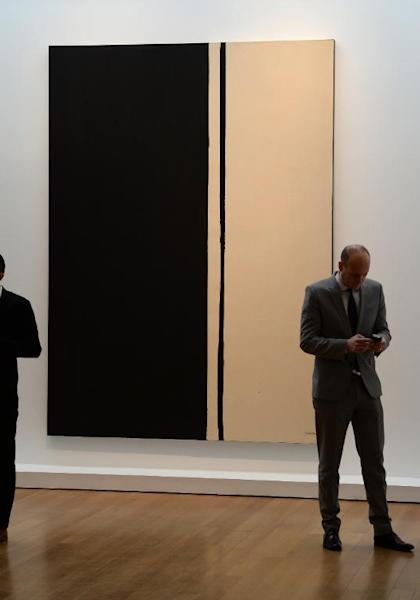 Barnett Newman's 'Black Fire I', painted in 1961, seen during a preview of the Impressionist and Modern Art sale at Christie's, on May 2, 2014