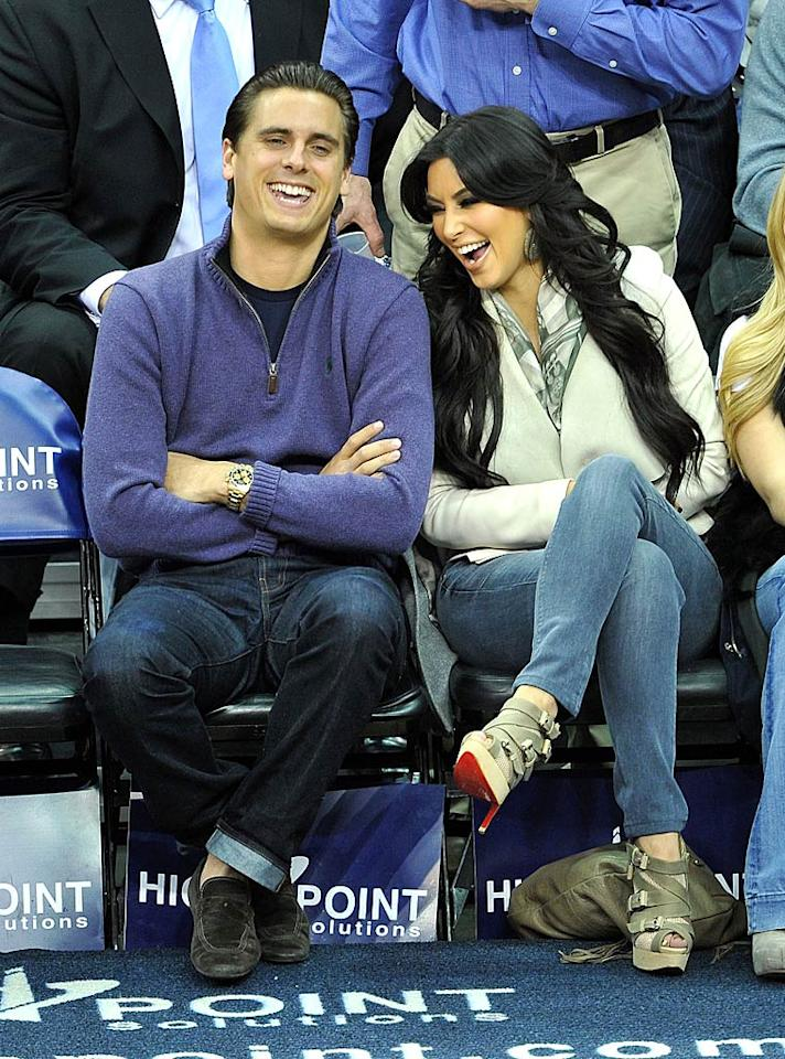 "Proving that they get along just fine off-screen, ""Kourtney and Kim Take New York"" reality stars Scott Disick and Kim Kardashian were all smiles at Wednesday's New Jersey Nets game against the Utah Jazz in Newark, New Jersey. The pair sat front row to cheer on Kim's new beau, Nets player Kris Humphries. James Devaney/<a href=""http://www.wireimage.com"" target=""new"">WireImage.com</a> - January 19, 2011"