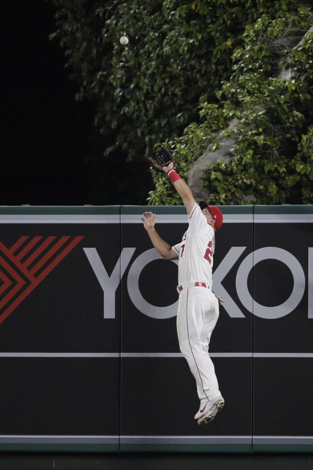 Los Angeles Angels' Mike Trout leaps to catch a ball hit by Milwaukee Brewers' Christian Yelich during the third inning of a baseball game, Monday, April 8, 2019, in Anaheim, Calif. (AP Photo/Jae C. Hong)