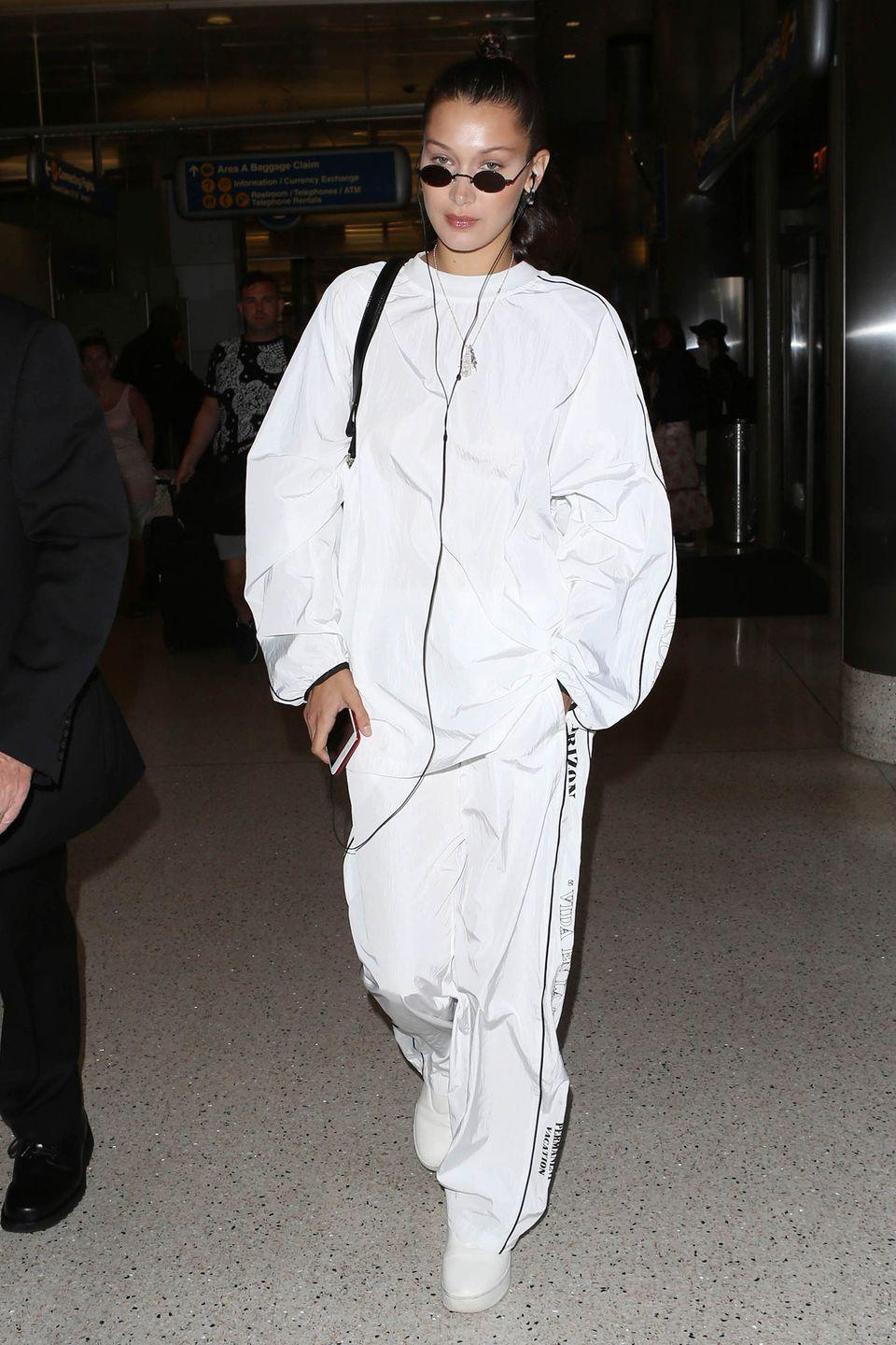 <p>In head-to-toe white pairing baggy track pants with an over-sized pullover, sneakers and small circular shades while out in LA. </p>