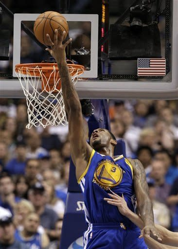 Golden State Warriors' Jeremy Tyler (3) attempts a reverse layup against the Dallas Mavericks in the first half of an NBA basketball game Friday, April 20, 2012, in Dallas. (AP Photo/Tony Gutierrez)