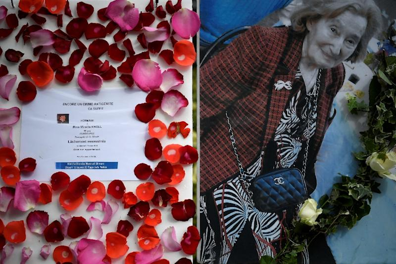 A picture of Mireille Knoll and a message announcing a silent march in her memory outside her apartment building in Paris on Tuesday (AFP Photo/Lionel BONAVENTURE)