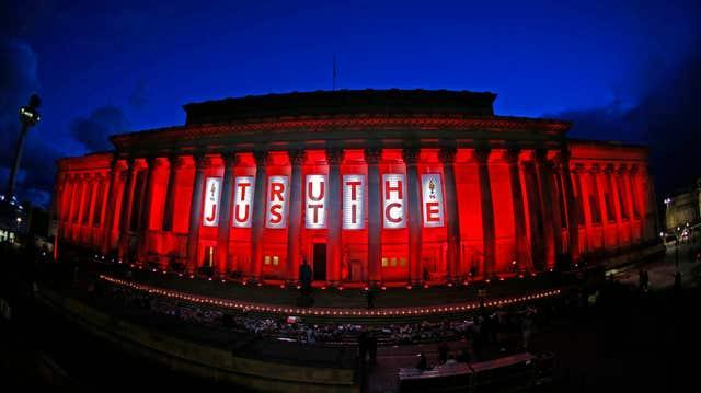 St George's Hall in Liverpool is illuminated following a special commemorative service to mark the outcome of the Hillsborough inquest, which ruled that 96 Liverpool fans who died as a result of the Hillsborough disaster were unlawfully killed
