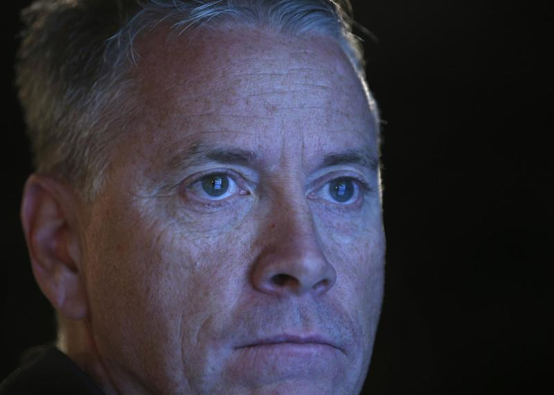 Former Atlanta Braves pitcher Tom Glavine views a display of baseball records and the stories behind them during his orientation visit at the Baseball Hall of Fame on Monday, March 17, 2014, in Cooperstown, N.Y. Glavine will be inducted to the hall in July. (AP Photo/Mike Groll)