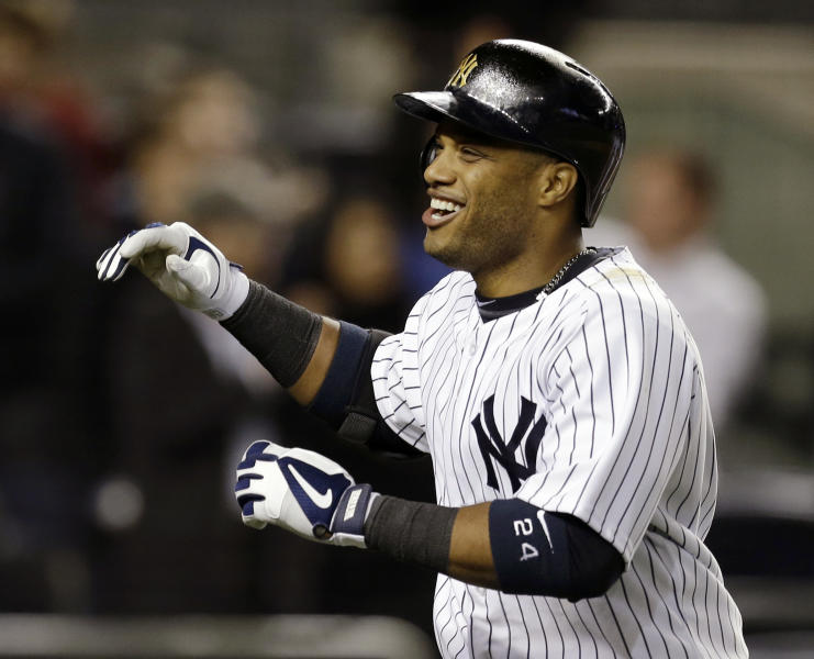 New York Yankees' Robinson Cano celebrates crossing the plate after hitting a fourth-inning, three-run home run off Arizona Diamondbacks starting pitcher Brandon McCarthy in a baseball game at Yankee Stadium in New York, Tuesday, April 16, 2013. (AP Photo/Kathy Willens)
