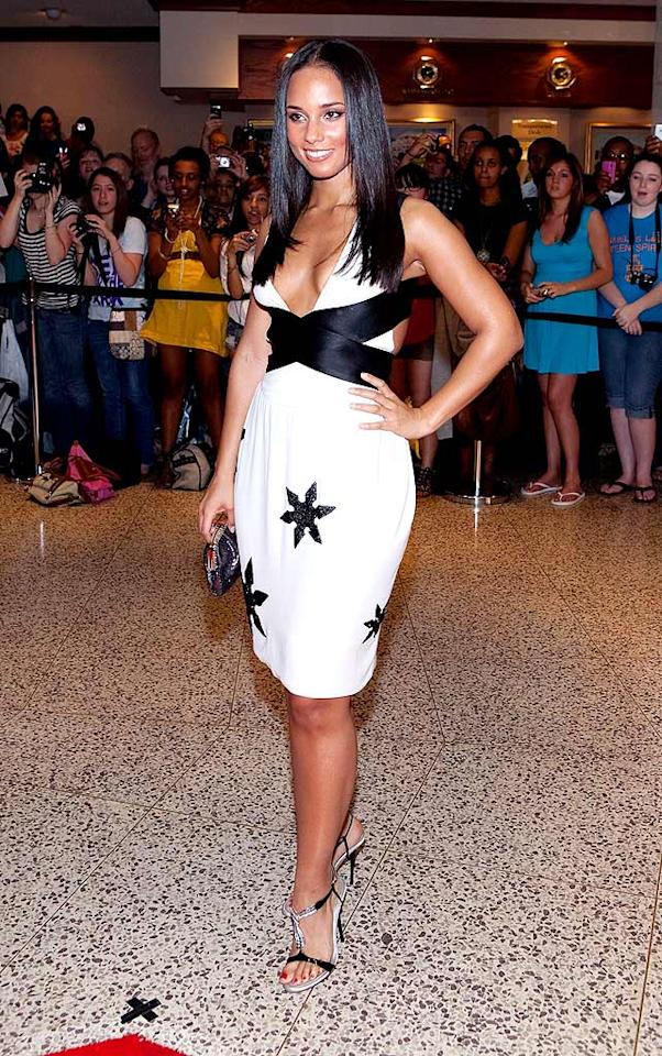"""Who knew Alicia Keys was willing and/or able to sport a sexy yet sophisticated ensemble? The black-and-white Narciso Rodriguez cocktail frock and strappy stilettos, which she wore to the recent White House Correspondent's Dinner, were simply stunning. Paul Morigi/<a href=""""http://www.wireimage.com"""" target=""""new"""">WireImage.com</a> - May 9, 2009"""