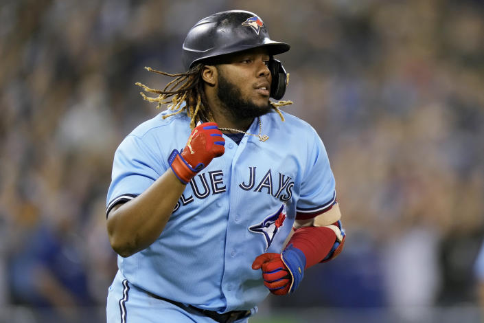 Toronto Blue Jays designated hitter Vladimir Guerrero Jr. rounds the bases after hitting a two-run home run against the Baltimore Orioles during second-inning baseball game action in Toronto, Sunday, Oct. 3, 2021. (Frank Gunn/The Canadian Press via AP)