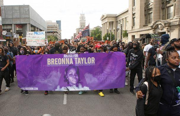 PHOTO: Protesters march through downtown Louisville after a grand jury decided not to bring homicide charges against police officers involved in the fatal shooting of Breonna Taylor, in Louisville, Ky., Sept. 25, 2020. (Lawrence Bryant/Reuters, FILE)